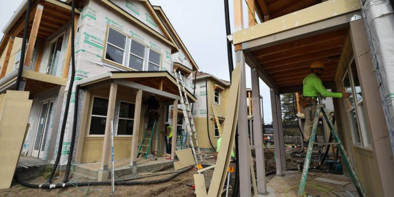 Construction crews work at Windsor Veterans Village in Windsor on Tuesday, February 9, 2021.  The project includes 60 affordable housing units for low-income veterans and their families.  (Christopher Chung/ The Press Democrat)