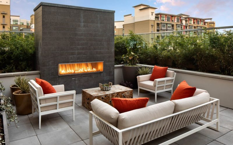 huxley-apartments-outdoor-lounge-and-fireplace